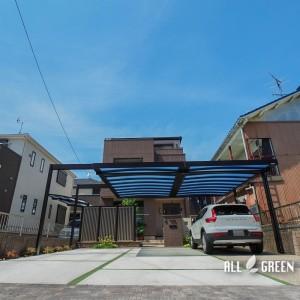 nakagawa_i_03792_10-300x300 中川区のリフォームでつくられたシンプルなフォルムでカッチリ決まったカーポートとグリーンの目地が優しい印象の駐車スペース