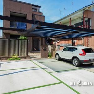 nakagawa_i_03792_6-300x300 中川区のリフォームでつくられたシンプルなフォルムでカッチリ決まったカーポートとグリーンの目地が優しい印象の駐車スペース